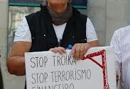 Woman with 'Stop Troika' sign